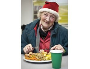 old lady eating christmas dinner